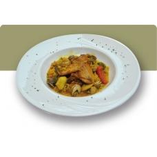 Arroz meloso con verduras, conejo y caracoles